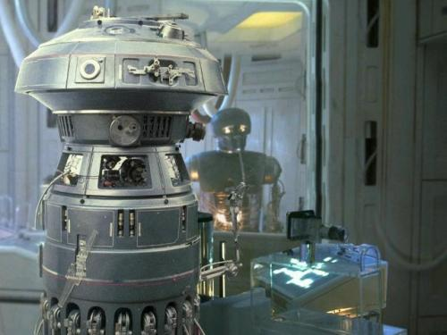 FX-7 is the droid in the foreground.