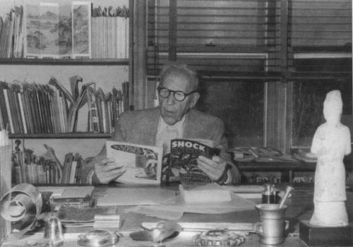 Dr. Fredric Wertham reading a comic book as part of his research.
