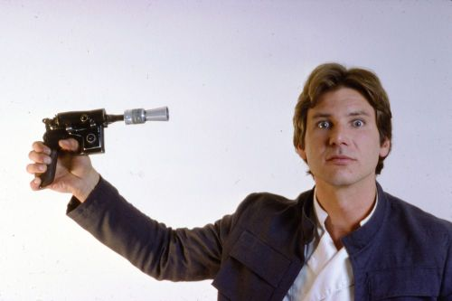Harrison Ford having some fun at a photo shoot for Star Wars.