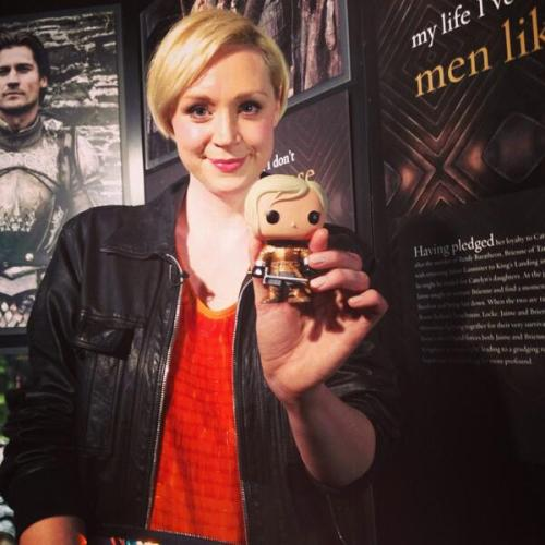 Christie at a Game of Thrones Exhibit Party displaying the Brienne of Tarth FunkoPOP figure (@gameofthrones, 2014)
