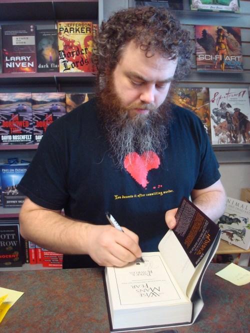 Rothfuss signing his second book (via blog.patrickrothfuss.com)